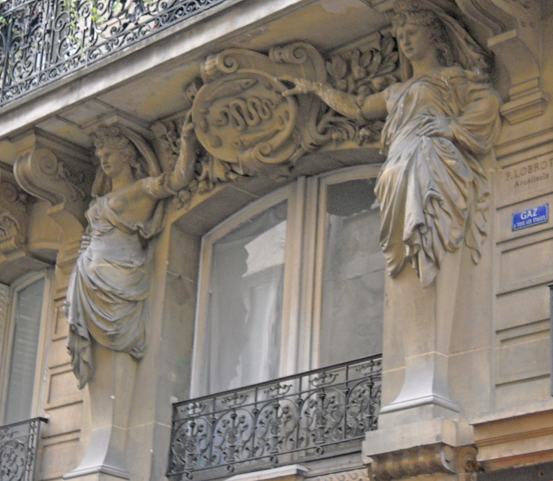 statues surround window