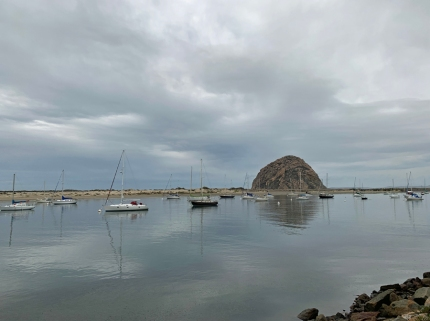 Morro Bay with Morro Rock in the background with a gorgeous sky.
