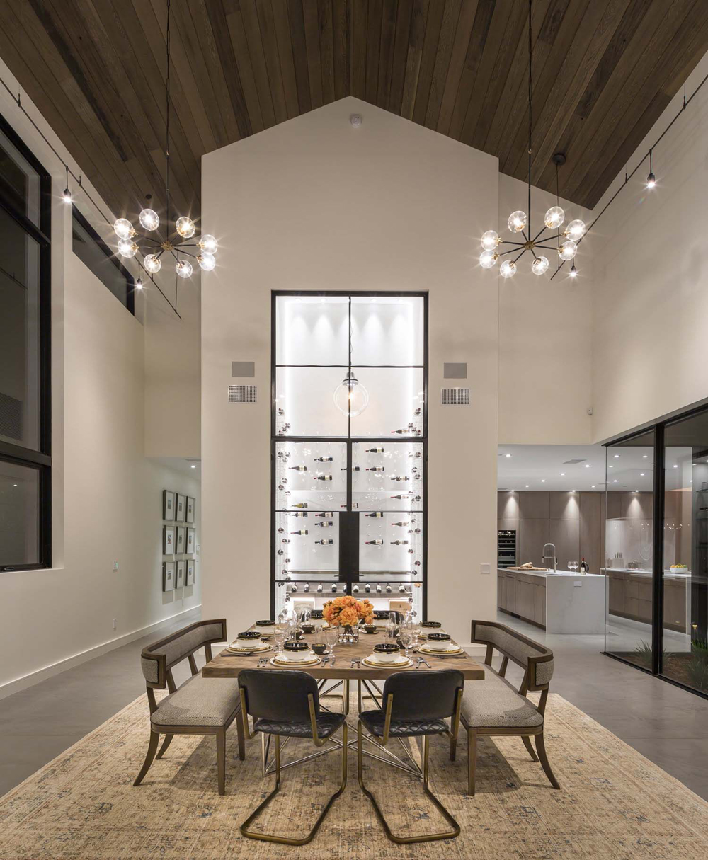 Dining room in a large scale modern farmhouse.