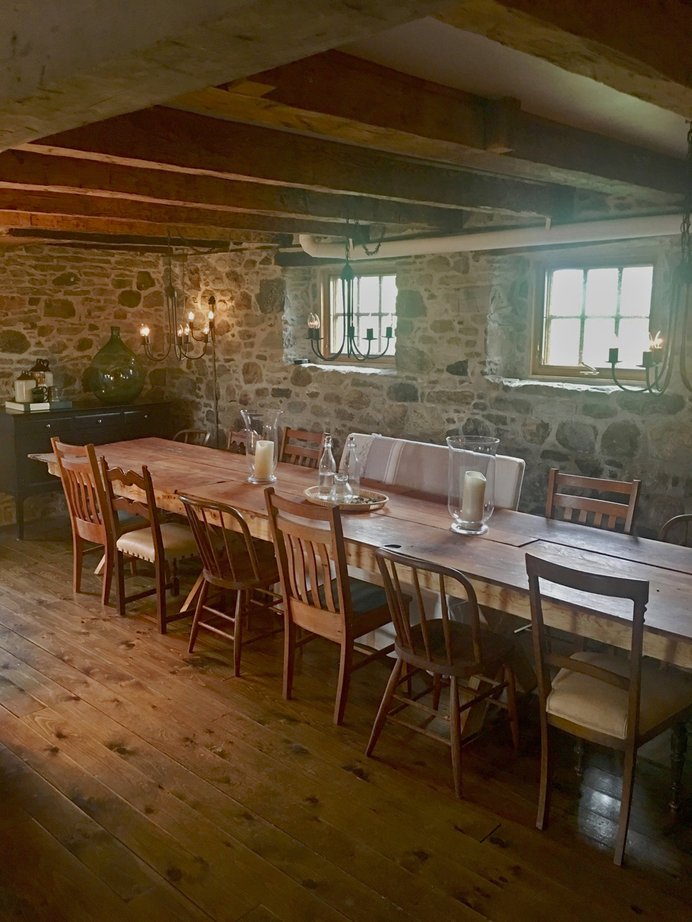 Dining room in a low-ceiling old stone house.