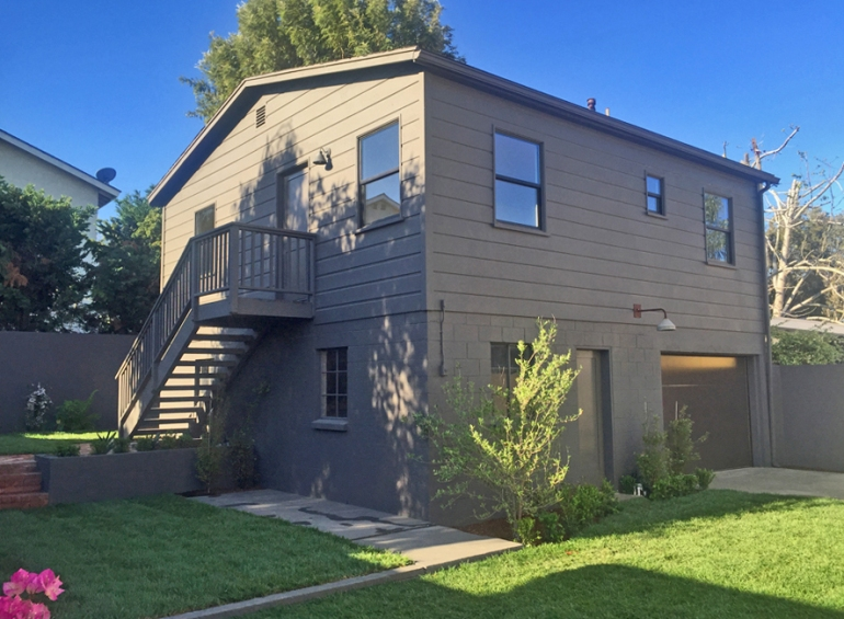 """Back guest house at the Palm Modern Farmhouse project. This black guest house was painted in """"Intellectual"""" from Sherwin Williams."""